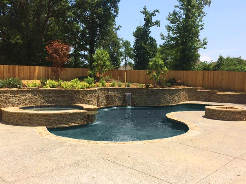 custom pool with natural stone wall