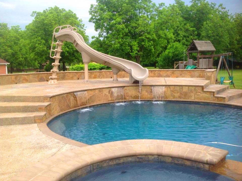 in-ground pool with water slide