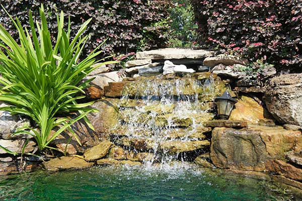 waterfall and spa construction with natural stone design