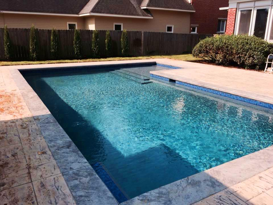 pool cponstruction with marble edging
